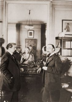 Composer Erik Satie visits Claude Debussy at Debussy's home in 1911.