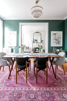 The best pairing with a jewel-toned wall? A complimentary rug of course!