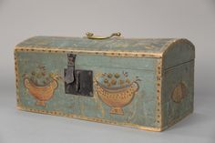Primitive document box having domed top and original blue paint, decorated with compotes.  ht. 8 1/4 in.; wd. 17 1/2 in.  Realized Price: $6,300.00