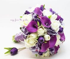 "White Real touch roses with Real Touch purple calla lilies, silk hydrangea in lavender and Real Touch purple mini tulips create a lovely flower bridal bouquet that can be yours to have & to hold on your wedding day! I can create it for you as shown or customize it to fit your color scheme. We can work together to create a custom silk flower wedding package for your entire wedding party! This custom silk flower bridal bouquet is 10"" in diameter and includes purple Real Touch mini ..."