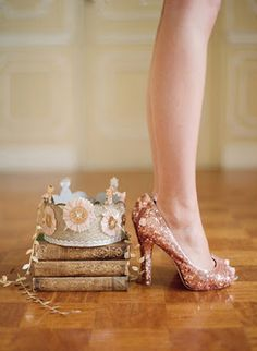 Books, crown and pink glittery heels