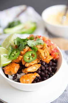 Buffalo Chicken Burrito Bowl with Lime, Cilantro, and Garlic.