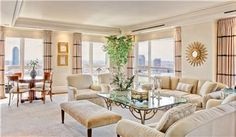 A 2-bedroom, 3-full bath, 2-half bath home in Sutton Place's iconic St. James Tower, this condo spans the 25th and 26th floors, linked by a chandelier-lit, curved staircase.