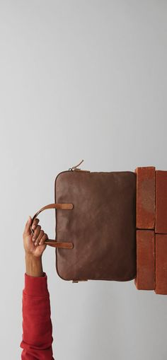 2d89dd7be8fe Dominic is a classic leather folio bag with bridle leather handles and an  adjustable and removable