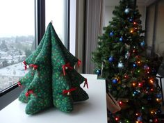 """Tasia writes: """"I post this or a version of it every year, it's the stuffed Christmas tree I made when I was I love it and I've kept it all these years . 3d Christmas Tree, Fabric Christmas Trees, Christmas Tree Pattern, Christmas Is Coming, Christmas Stockings, Christmas Wreaths, Merry Christmas, Christmas Decorations, Holiday Decor"""