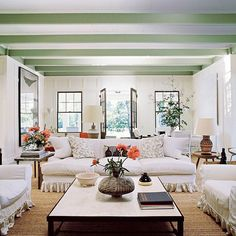A beautiful green hue stands out against the creamy slipcovered furniture and white walls @voguemagazine #livingroom #interiordesign #interiors