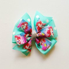 Little Mermaid pinwheel bow by ByrdieNestDesigns on Etsy
