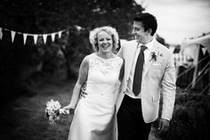 We love a vintage black and white! Sophie here with her new hubby wearing 'Anoushka' | A-Line | Wedding dress | Floral | Bunting | Amanda Wyatt |