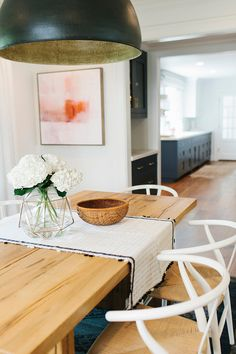Transitional Dining Room with Farmhouse Table and Wishbone Chairs. #TransitionalDiningRoom #Wishbone #Chairs Shea McGee Design.