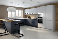 MODENA KITCHEN Using our new matt lacquer finishes we've combined the calming grey tones of Dove Grey and Charcoal together creating a contemporary two tone effect. The solid colour door finish has a calming effect and blends easily with the overall décor, making the kitchen feel spacious and lighter. Therefore we often use wood grains as the accent colour for the cabinet, shelving or feature panels.
