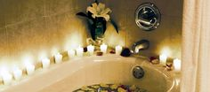 Candles and rose petals in the bathtub