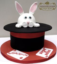 Magic themed birthday cake.  Top hat with rabbit