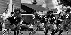 Vintage American Football Game -2016 1920's football player with replica equipment and 1920 rules. Photo of 2016 Game - QC Times 8-29-2016