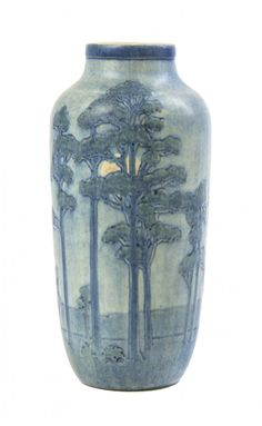 A Newcomb College Art Pottery Vase, 1929, decorated by Sadie Irvine with the Tall Pine and Moon landscape design modeled in high relief, matte glaze with blue, green and yellow underglaze, base marked with Newcomb cipher, decorator's mark, Jonathan Hunt's potter's mark, reg. no. RT43 and shape no. 330, height 9 1/16 in