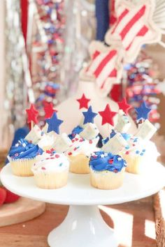 Take a look at the fun mix of blue and white frosted cupcakes with red and blue stars at this boho July 4th picnic! See more party ideas and share yours at CatchMyParty.com