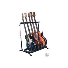 Guitar Racks ❤ liked on Polyvore featuring fillers, instruments, music, guitars and items