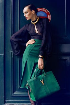 YSL bag + flowy long sleeve blouse + green skirt with pleats