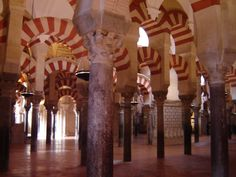 Mezquita or Great Mosque, Cordoba Spain,  8th-10th c.              Hypo-style mosque (500+ columns: reused roman solia)             MURAB=always face mecca             SQUINCHES= arches that cut corners, create octagon support dome
