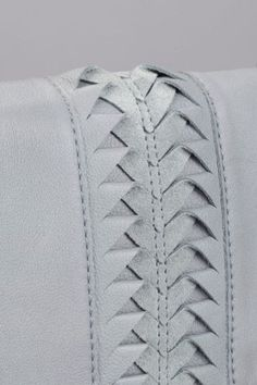 A simple repeated cut and fold can add the perfect amount of interest to a piece of leather Fabric Manipulation Techniques, Textiles Techniques, Sewing Techniques, Couture Details, Fashion Details, Leather Weaving, Leather Craft, Conception En Cuir, Fabric Patterns