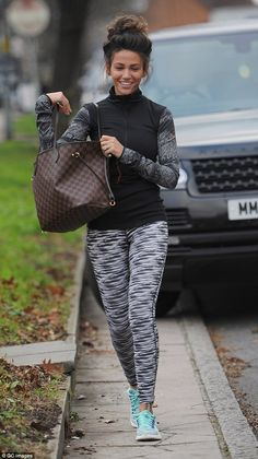 Making the most of what she's got: The 28-year-old showed off her incredibly lean, toned legs in a pair of skintight black and white leggings, teamed with bright trainers and a snug gym top
