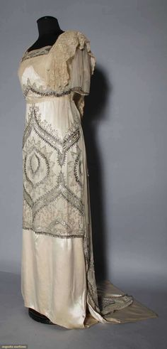 BEADED IVORY EVENING GOWN, 1912 Skirt & bodice w/ designs worked in silver & crystal beads