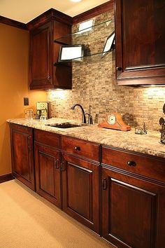 Mosaic tiling compliments a warm granite countertop.