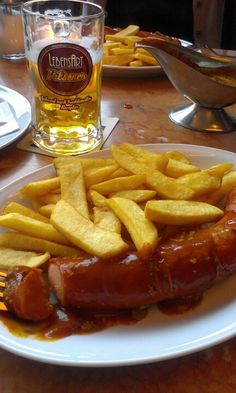 """Berlin: """"Curry Wurst"""" .. with a beer ;-), typically German. You can get it at lots of food stands everywhere. SOOOO YUMMY!"""