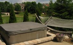 The Site Group in New Carlisle, OH was smart to build the paver patio right up to the hot tub, creating a nice step in point that blends right into the outdoor space. http://www.sitegrouplandscaping.com #housetrends