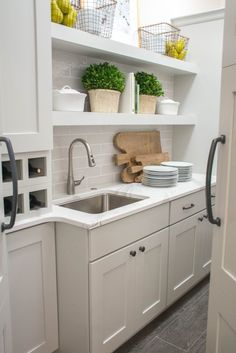 Walk-in Pantry with White and Gray Cabinets and Sink. Image via Mandy McGregor…