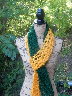 This two-tone scarf is long enough to be tied in many different ways or just wrapped around your neck. It has a very open weave to it but when
