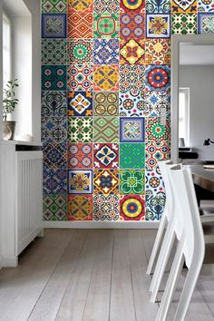 We still a completely adore a colorful feature wall!  #colorfultiles #tiledwalls #colorfulinteriors