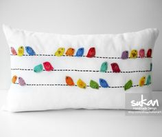 Cute Birds on a Wire pillow - might be able to reproduce this w/ felt & embroidery thread on a pre made linen pillow cover?