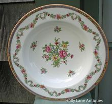 A Lovely Shallow Soup / Salad Bowl Of Copeland Spode England -    Floral Pattern Featuring A Center Bouquet Of Flowers Along With Smaller Flowers And A Border Garland That Fills The Wide Rim. The Very Edge Has An Intricate Border.  $32.00