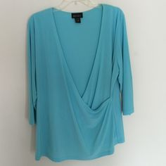 Turquoise SEXY blouse Lane Bryant SEXY blouse. This is SO SEXY on!!!! A real winner! Absolutely turns heads. Lane Bryant Tops Blouses