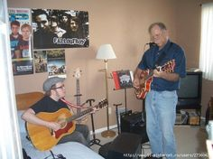 Patrick Stump with his father. I love how they have Fall Out Boy posters and the Fall Out Boy guitar books.