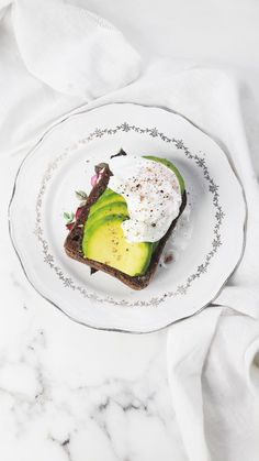 The BEST avocado toast recipe. This avocado toast is grainy, crunchy, has a layer of perfectly ripe, soft avocado and is topped with a runny poached egg. Avocado dreams do come true. | ahedgehoginthekitchen.com