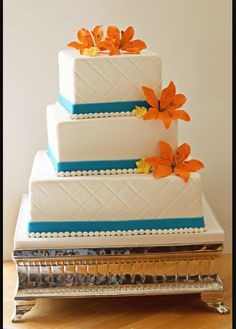 Orange teal wedding cake.... the perfect cake except I will use orange Gerber daisies