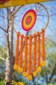This Mehndi inspirated DIY decor ideas of a Hoop with hanging marigold floral chains is great for Indian wedding decor - like at a sangeet or outdoor pre-wedding party Diy Mehndi Decorations, Mehendi Decor Ideas, Indian Wedding Decorations, Festival Decorations, Flower Decorations, Indian Decoration, Housewarming Decorations, Outdoor Decorations, Stage Decorations