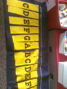 """Orff Keyboard made of felt for whole class instruction. Velcro on top to hold """"bars"""" up that are not being used."""