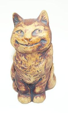 Vintage Grinning Cat Figurine by Unknown (No Mfg. Marks), http://www.amazon.com/dp/B00907OSCK/ref=cm_sw_r_pi_dp_Z.Rmqb1245FNE