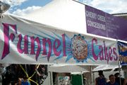 This booth specializes in funnel cakes and the banner advertizes it well. LOVE FUNNEL CAKES!!!