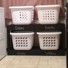 Love My Organized Laundry Room!!!  It was the perfect project for my boyfriend & I to do together...  He built it & I painted it with chalkboard paint so it can be changed anytime!  (Some day 1 of them with say 'Baby' , wash with extra <3)