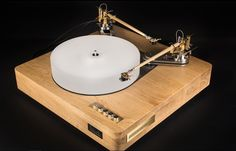 Turntable Wooden Speed:                        33,3 ; 45 rpm                         Signal to noise:           80 dB Motor: Three low speed (250 rpm)  synchronous Crouzet  motors Motor control: Stable frequency two phase motor  Power consumption:    20W Platter:                         weight- 5 kg, material - 60 mm. acrylic Bearing:                       Sliding bearing with magnetic pillow and vertical motion oil damper  Plinth material:            80 mm. oak Two adjustable armboards