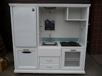 Kid's play kitchen. From old entertainment center, etc.