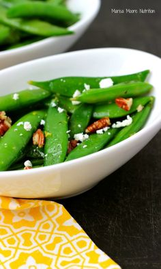 Sweet sugar snap peas combined with fresh lemon, parsley and toasted pecans provide a crisp bite to start the spring produce season.