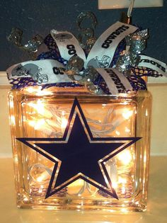 Dallas Cowboys Lit Glass Block with Bow by TheYellowDogSignCo Dallas Cowboys Room, Dallas Cowboys Crafts, Dallas Cowboys Wreath, Cowboy Theme, Cowboy Party, Cowboy Room, Cowboy Crafts, Glass Block Crafts, Lighted Glass Blocks