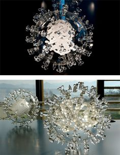 "This ongoing series, entitled ""Glass Microbiology"" features beautiful clear glass renderings of infectious diseases such as E. coli, Malaria..."