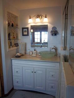 Basco custom glass shower enclosure, allen + roth white Northrup vanity, Formica® 180fx® Travertine Silver countertop, Delta Leland faucet, Portfolio lights, IVC Planet Charcoal flooring.