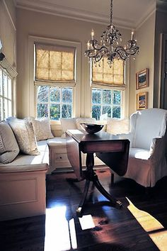 Window seats and a drop leaf table make the most of this small space