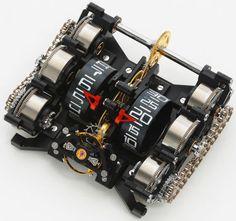 Rebellion T-1000 Watch Titan and 105k USD...( jo... 105000dolarů :) ) Unikátní systém uchování pohybové energie prostřednictvím patentovaného systému 6pružinových válců pro udržení hodu hodinek po dobu 1000hodin... :)
